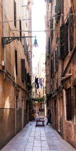 Photo of a delivery worker in an alley in Venice, Italy, by visionbypixels.com