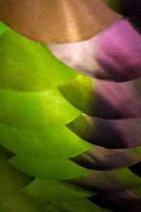 Abstract photograph of colored metal reflective patterns.